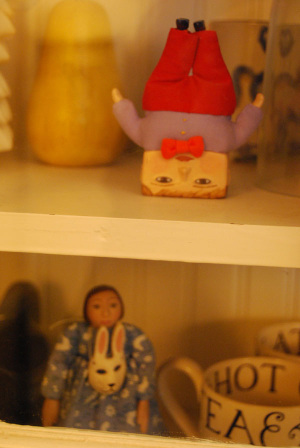 Mollys_dolls_in_cabinet